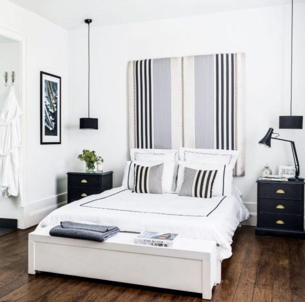dormitorio de matrimonio blanco y negro