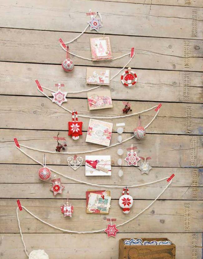 arbol de navidad hecho con cuerdas en pared