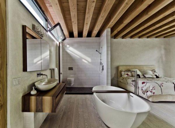 cuarto de baño abierto al dormitorio de matrimonio