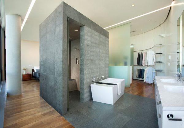 dormitorio con baño y vestidor integrado